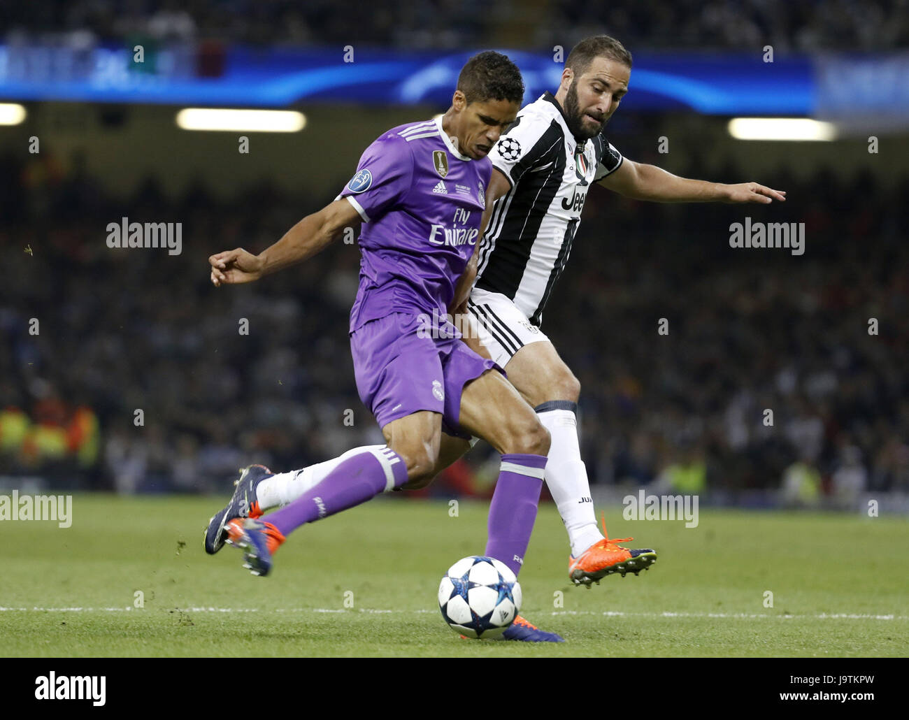 Real Madrid s French defender Raphael Varane L vies for the ball
