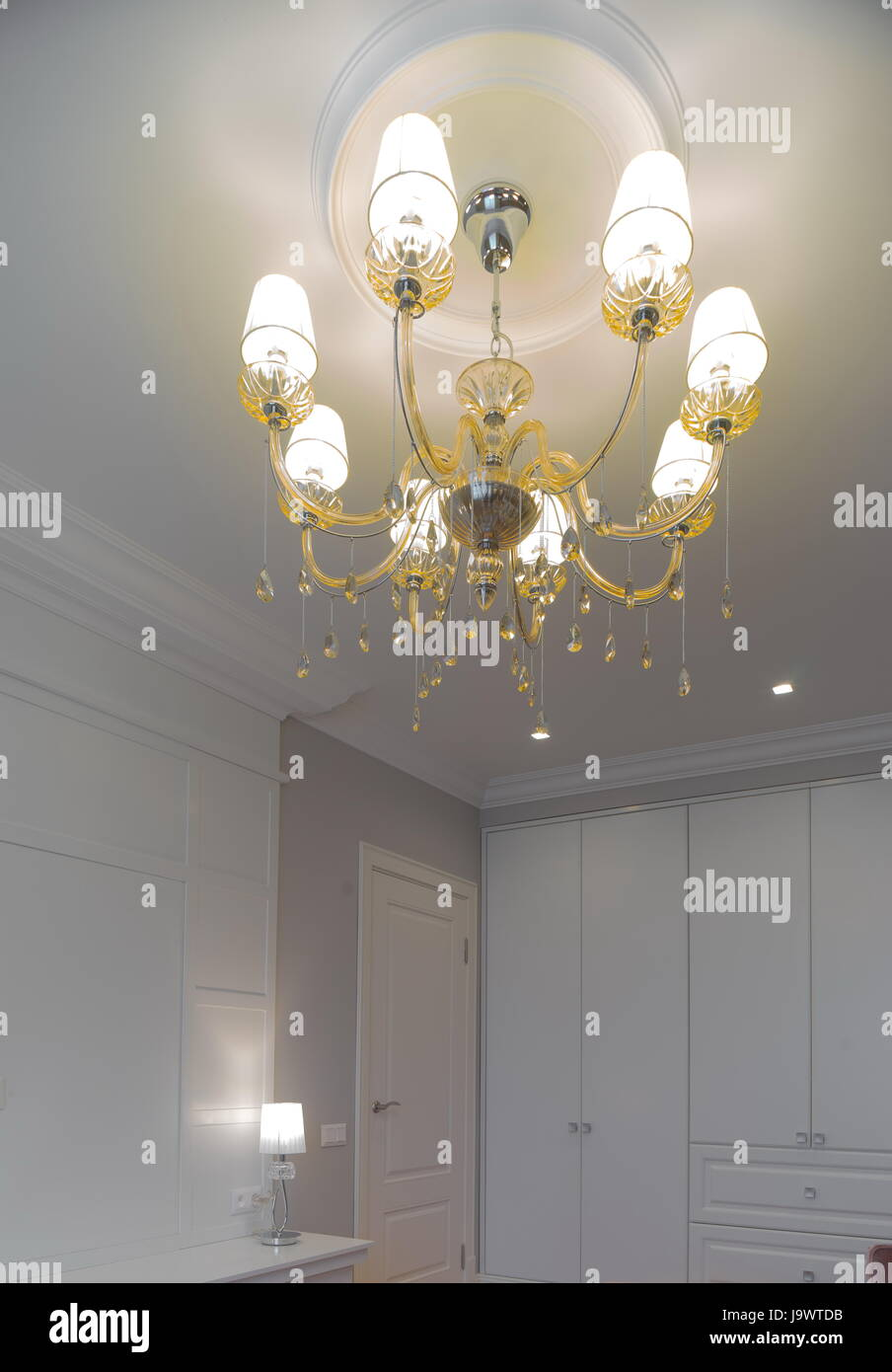 Elegant crystal chandelier on the ceiling stock photo royalty stock photo elegant crystal chandelier on the ceiling arubaitofo Choice Image