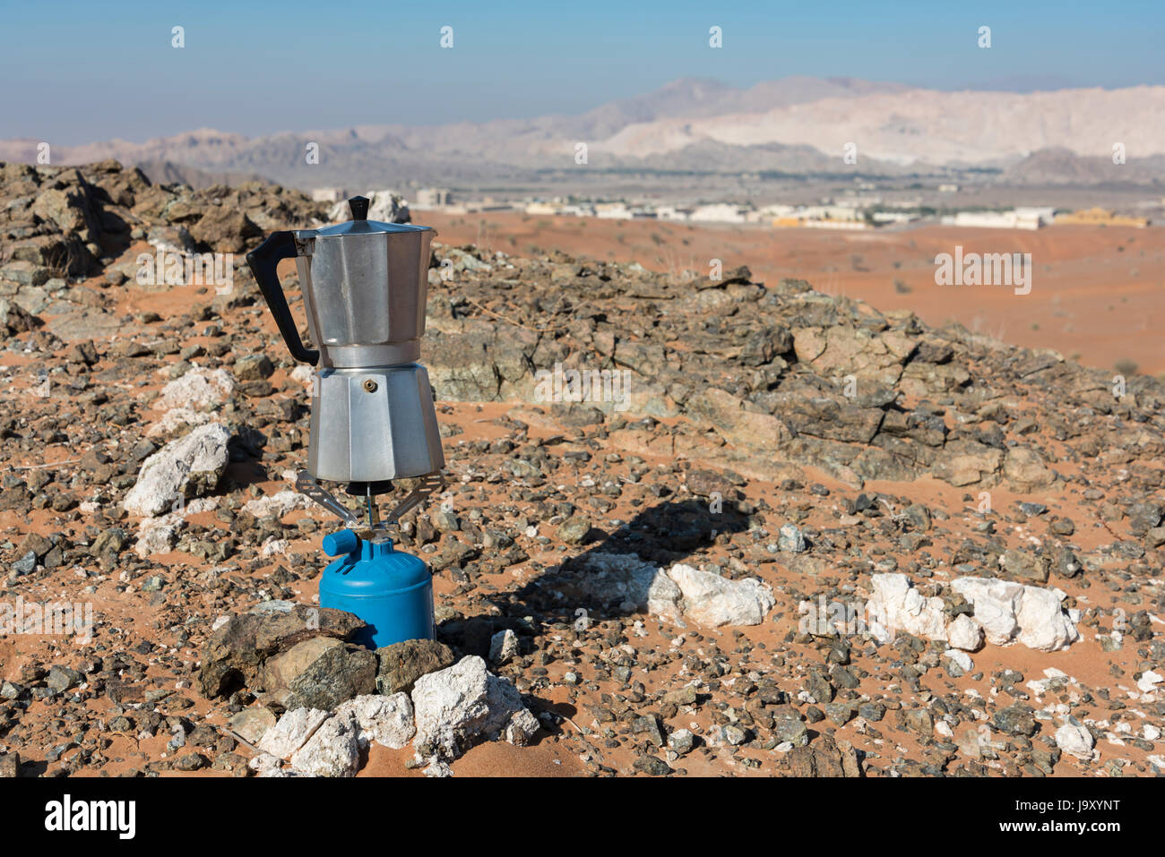 italian coffee maker boiling at a fireplace in the desert on