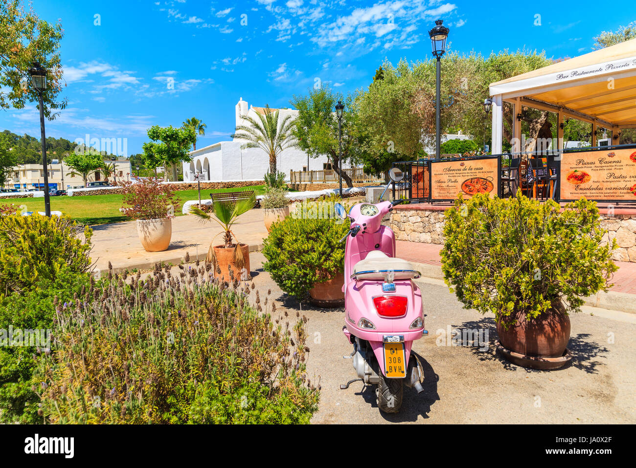 ibiza island, spain - may 18, 2017: classic pink vespa scooter