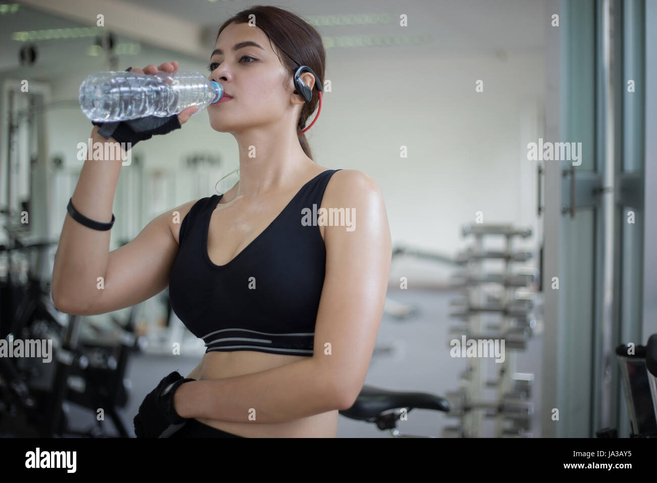 Sporty woman asia drinking water after exercises in the gym sporty woman asia drinking water after exercises in the gym fitness concept of healthy sciox Choice Image