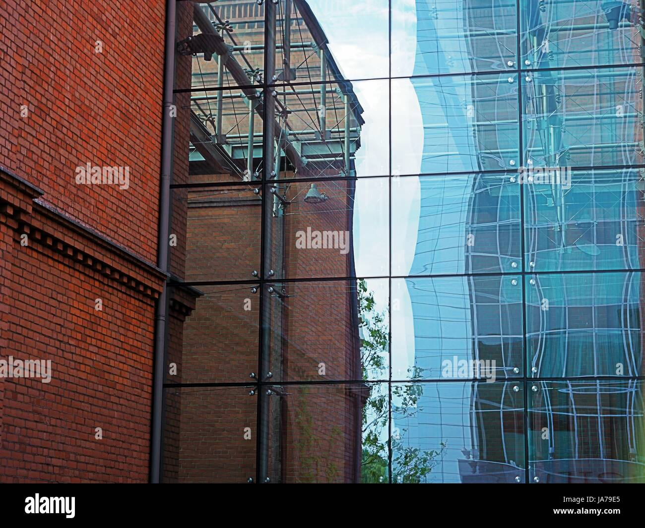 Office building, block, red brick, skyscraper made of metal and ...