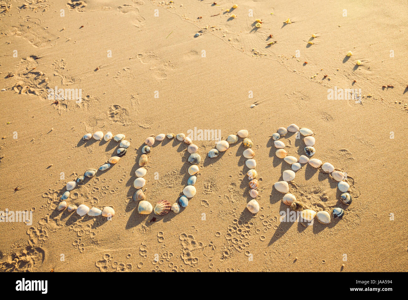 2018 New Year Text Made Using Shells On Sand At Glenelg