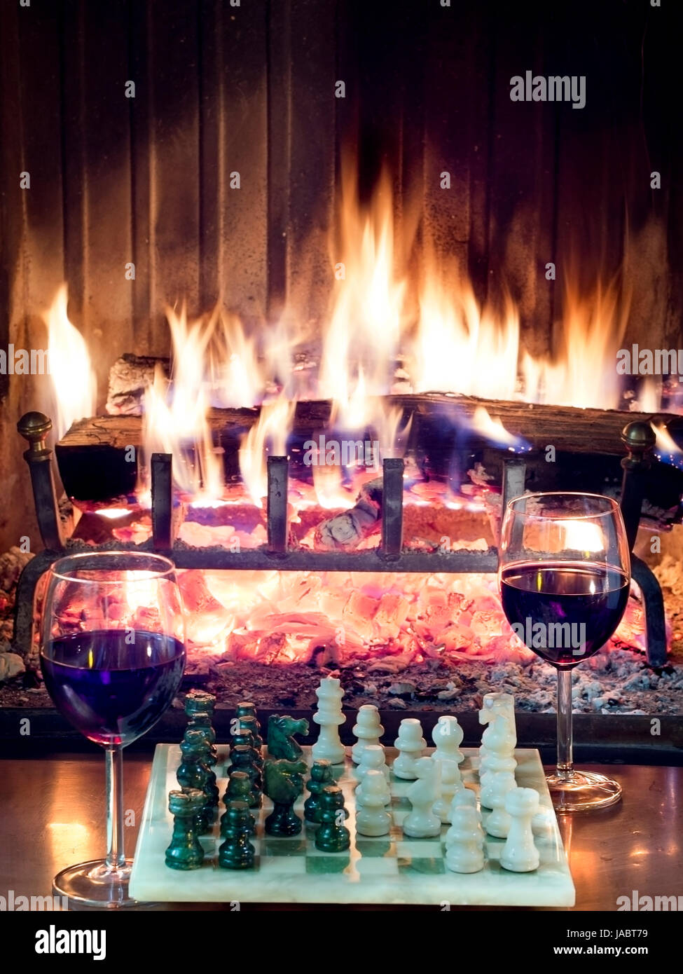 play chess drinking red wine in front of a roaring fireplace Stock ...