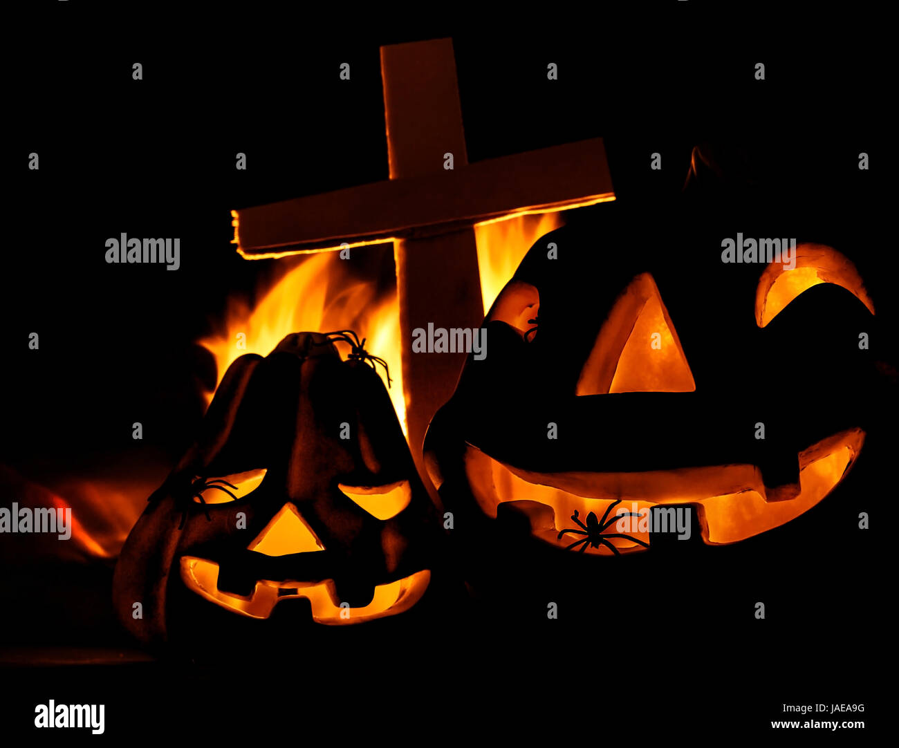 Scary glowing pumpkin decoration with creepy spider, burning fire ...