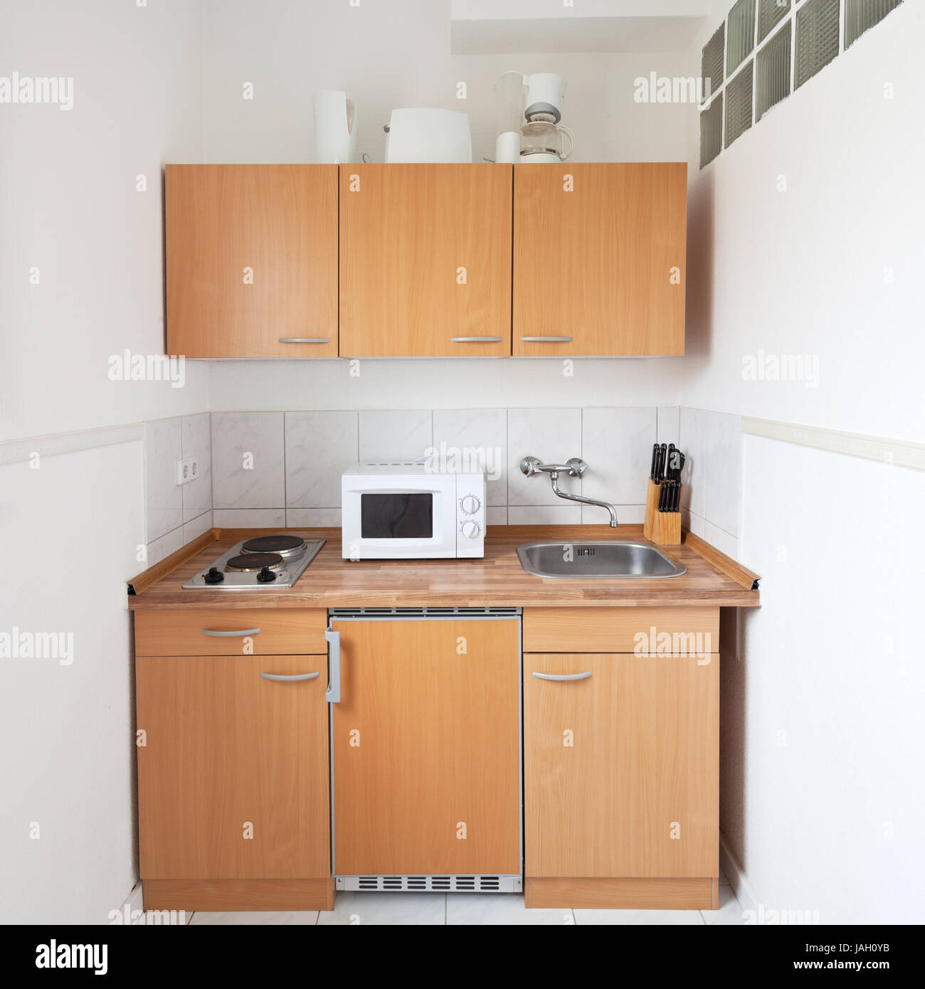Simple Kitchen Equipment simple kitchen with furniture set and kitchen equipment stock