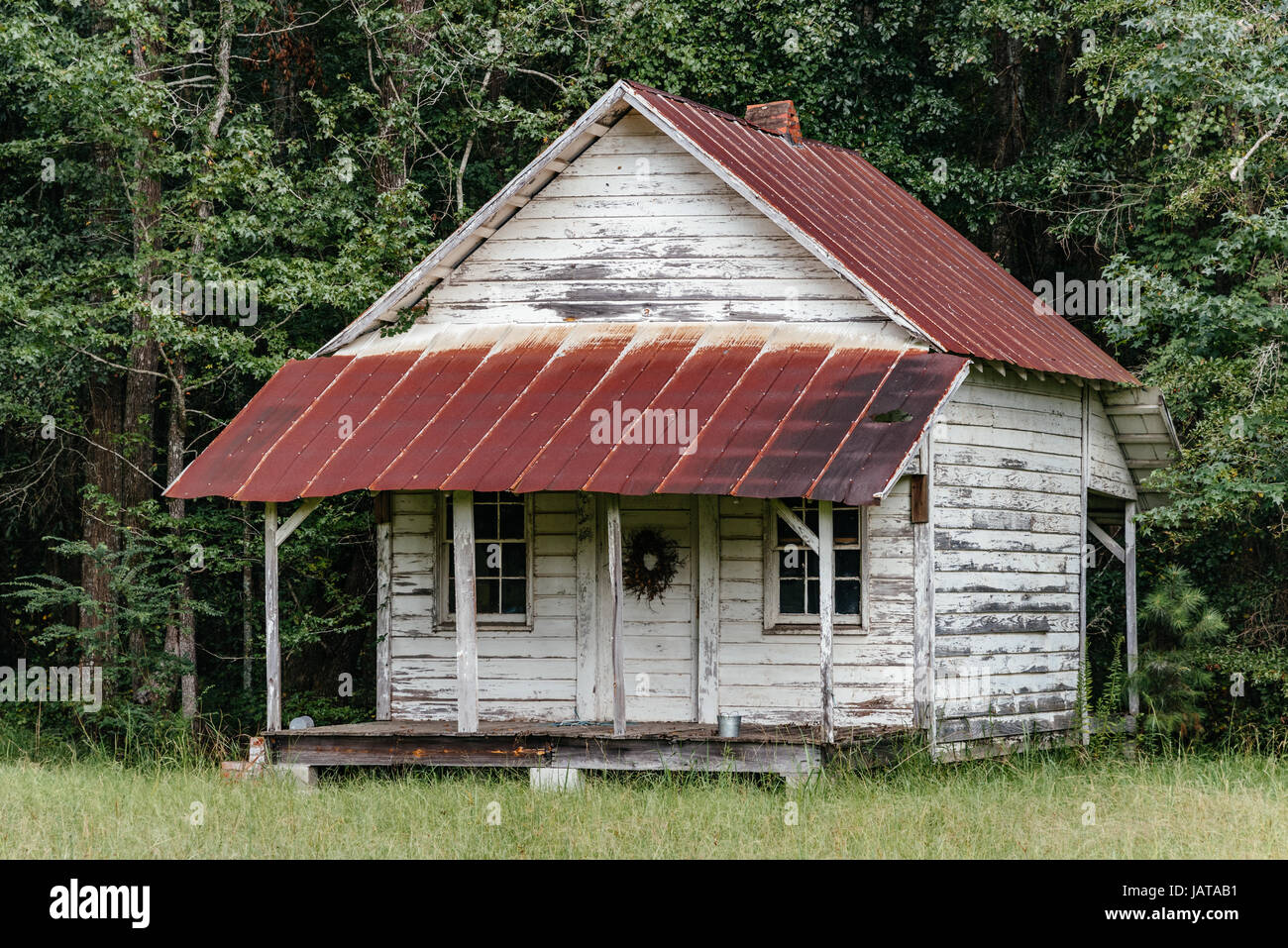 Old Abandoned Wooden Cabin With A Rusted Tin Roof In Rural Alabama, USA.