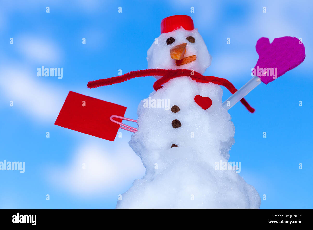 little happy valentine snowman in red scarf and with clip paper card text message heart outdoor