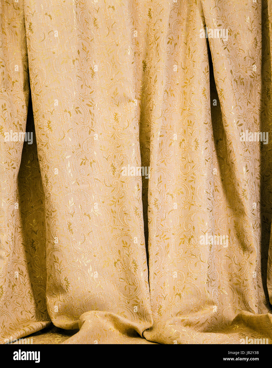 Hanging Drapes hanging drapes of gold damask with a luxurious pattern of shiny