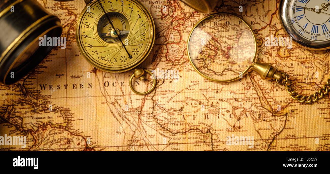 Old vintage retro compass and spyglass on ancient world map old vintage retro compass and spyglass on ancient world map vintage still life travel geography navigation concept background top view gumiabroncs Choice Image