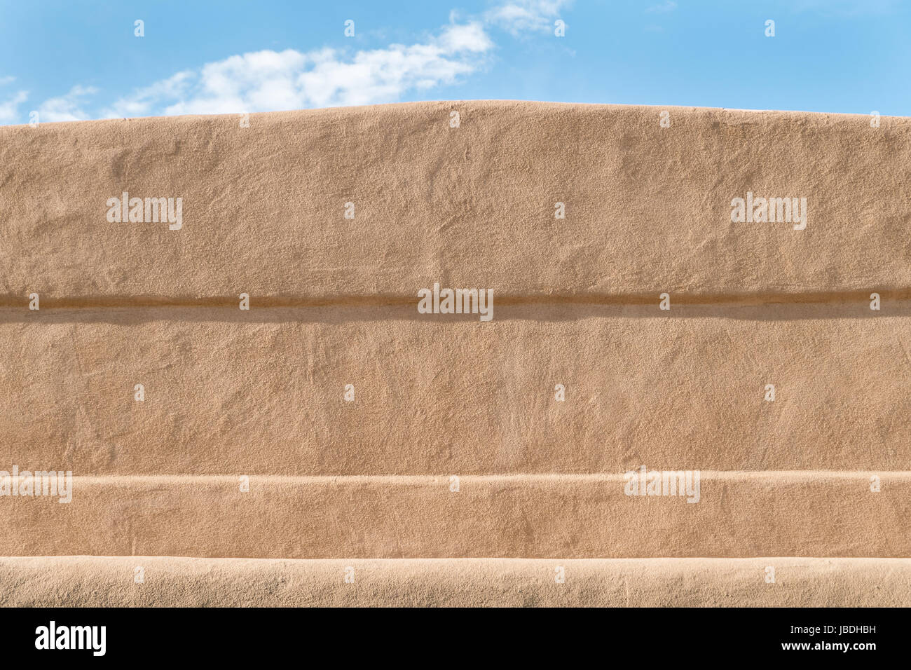 Close up of the texture of a adobe building in New Mexico with a