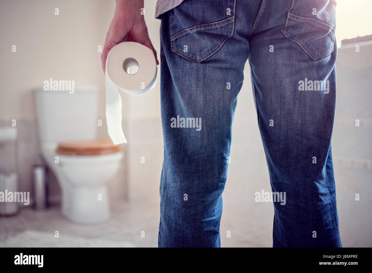 Man Holding Toilet Tissue Roll In Bathroom Looking At Loo Stock. Stunning Bathroom Loo Ideas   Home Design Ideas  Renovations