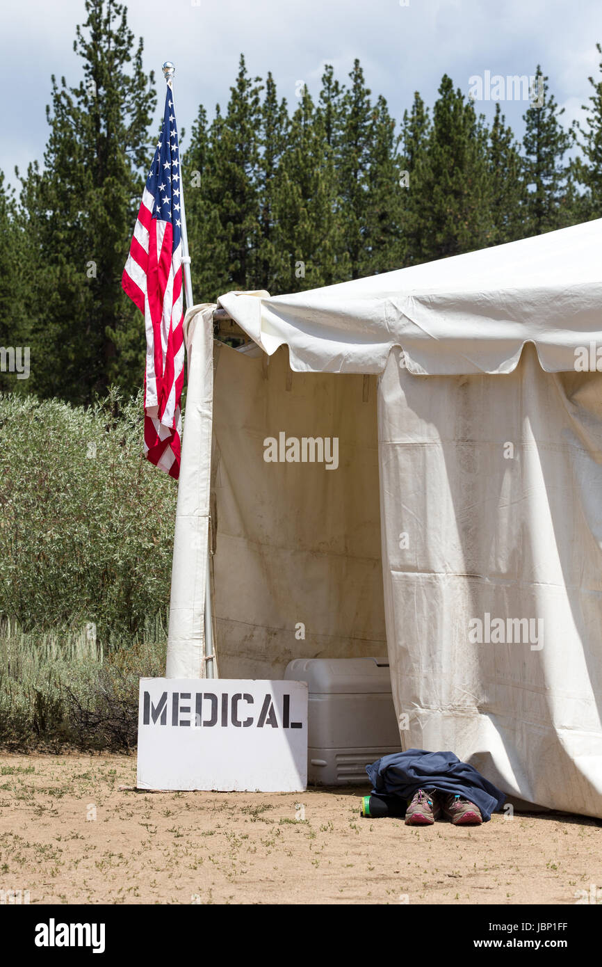 Medical tent entrance with a hand-made medical sign and an American Flag. Runners & Medical tent entrance with a hand-made medical sign and an ...