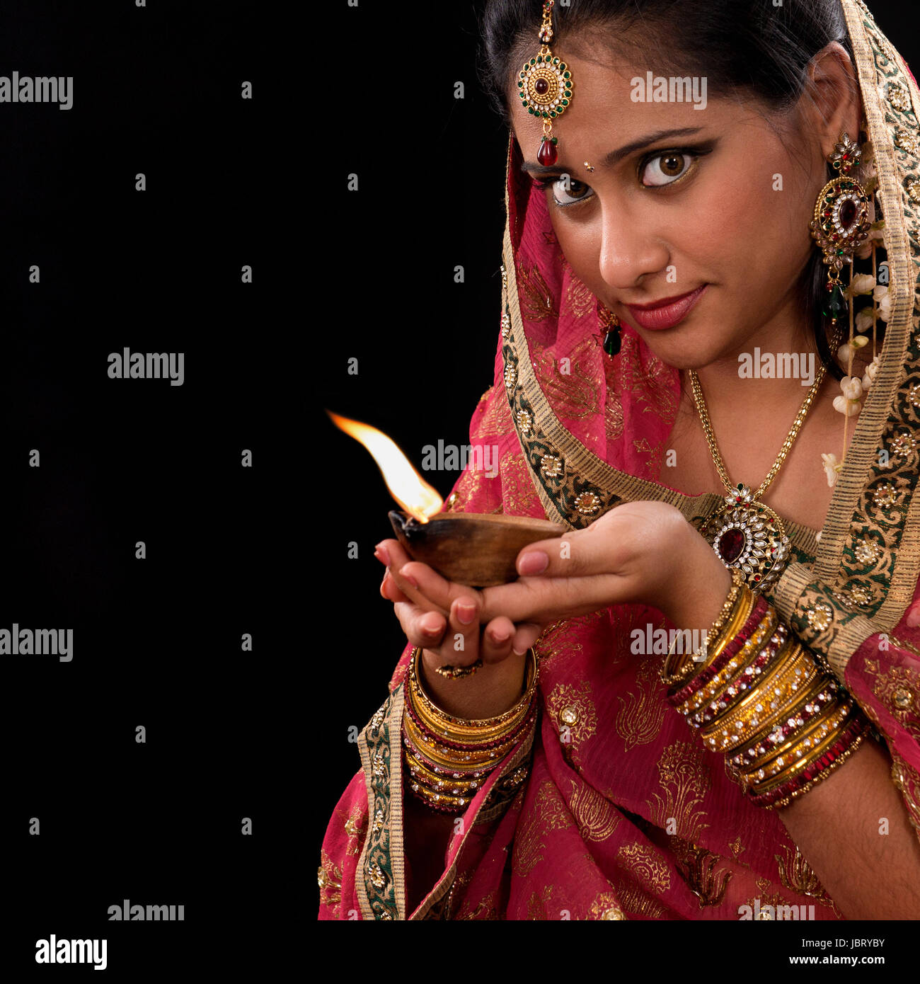 Beautiful Indian girl hands holding diya oil lamp, celebrating ... for Girl Holding Lamp  45ifm