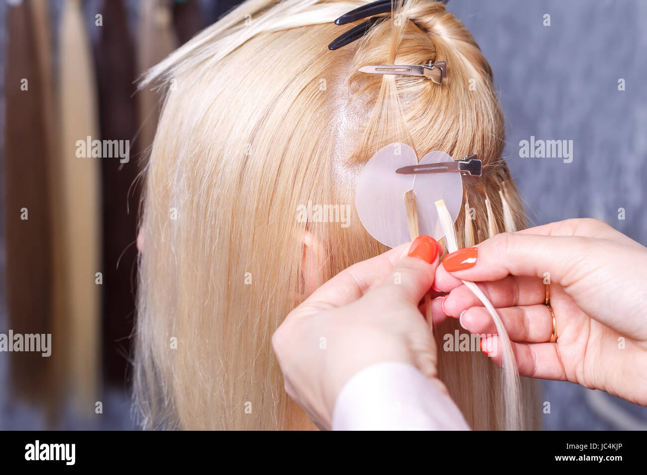 Hair extensions procedure hairdresser does hair extensions to hair extensions procedure hairdresser does hair extensions to young girl blonde in a beauty salon selective focus pmusecretfo Image collections