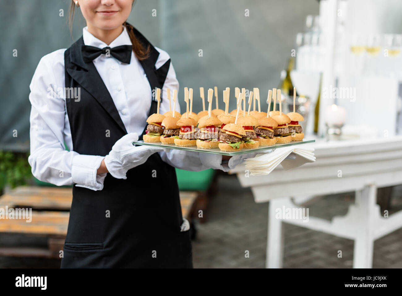 Catering Service Waiter Carrying A Tray Of Appetizers