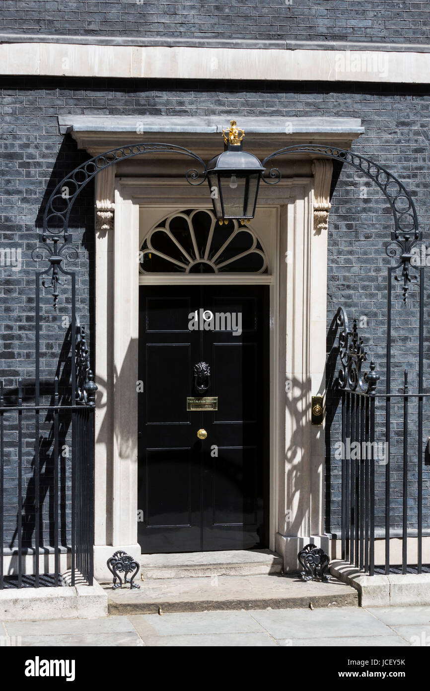 Black front door of No 10 Downing Street, Whitehall, London. The ...