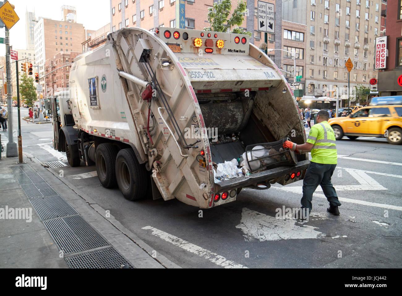 New York City Sanitation Truck Worker Emptying Street Bins