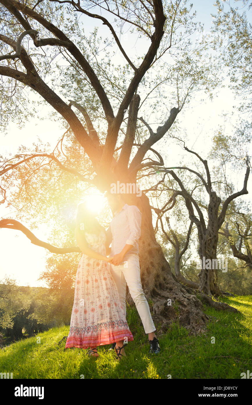 Beautiful Stock Photo. Couple Relax Under The Tree. Fine Art Style. Olive Garden.
