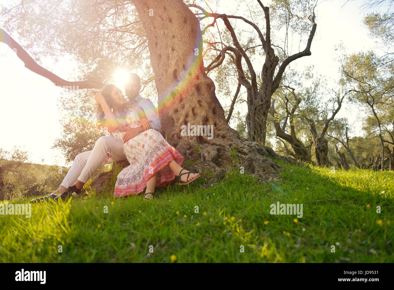 Stock Photo. Couple Relax Under The Tree. Fine Art Style. Olive Garden.