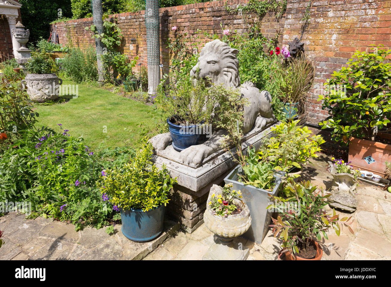 Large Garden Ornaments Including Lion Statues And Pots In An Ornate English  Garden, Kent England
