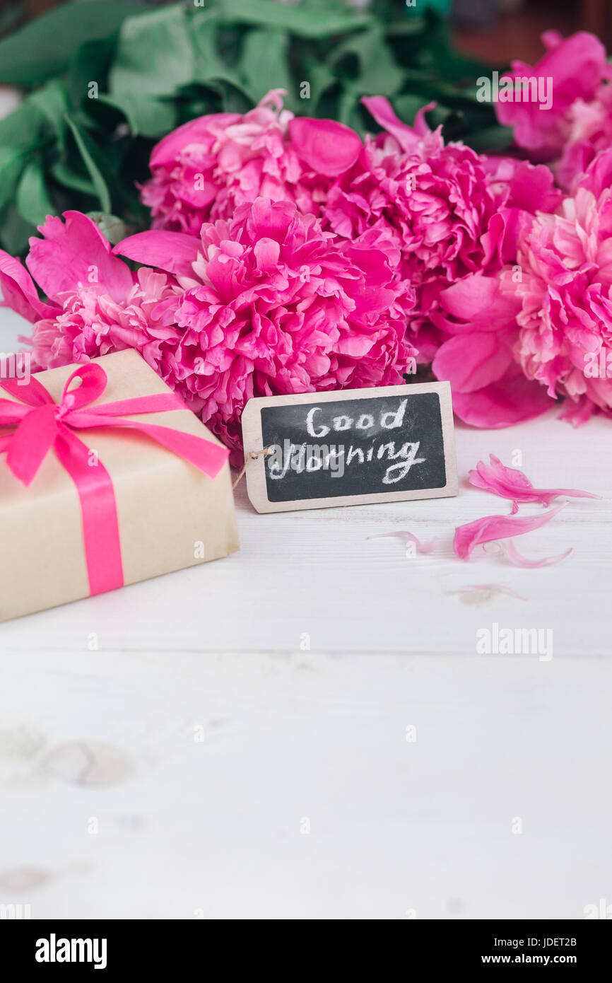Pink peony flowersgift box and notes good morning on white rustic pink peony flowersgift box and notes good morning on white rustic table from above breakfast on mothers day or womens day mmer flowers bouquet negle Images