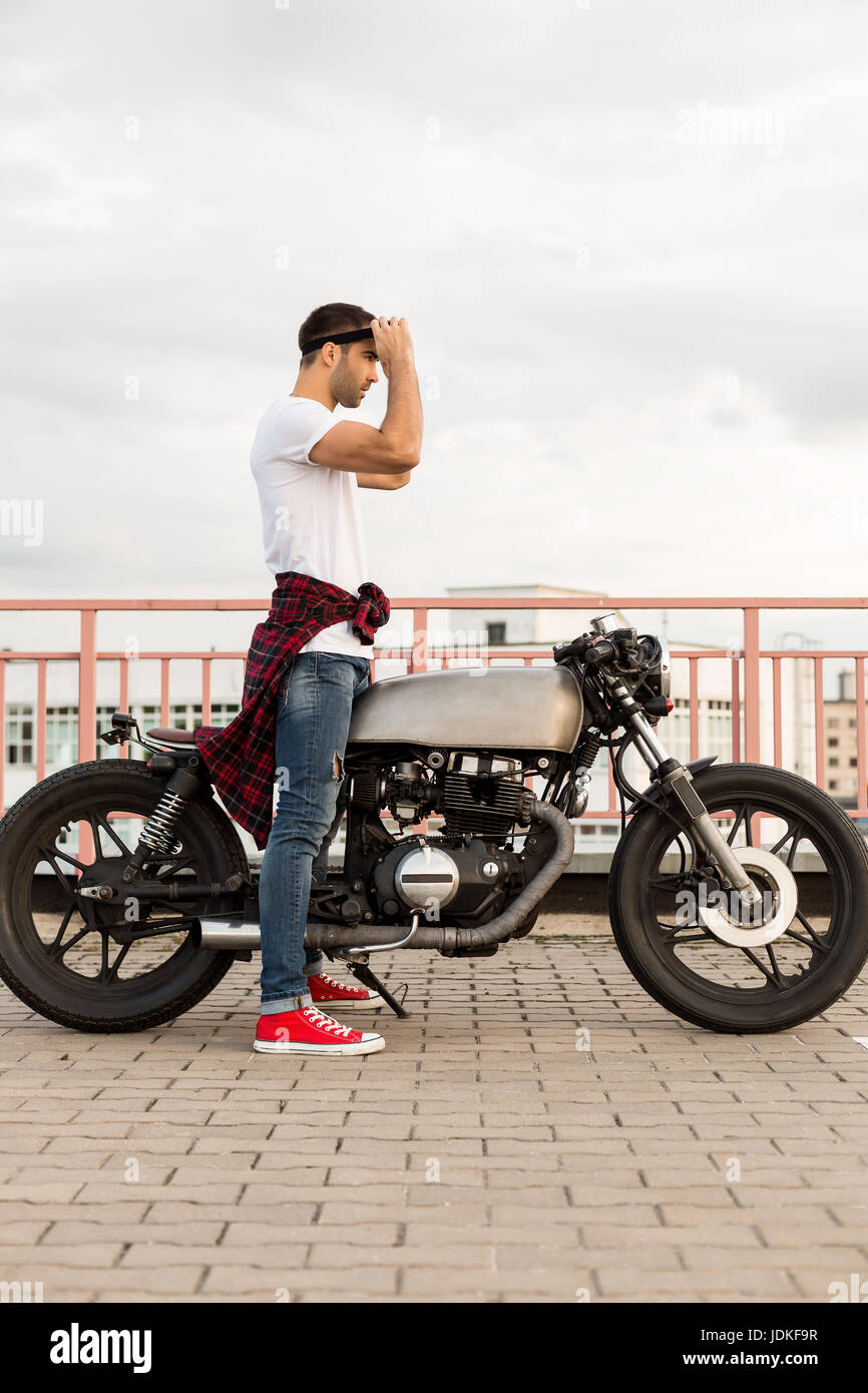 Handsome Rider Man With Beard And Mustache Put On Black Moto