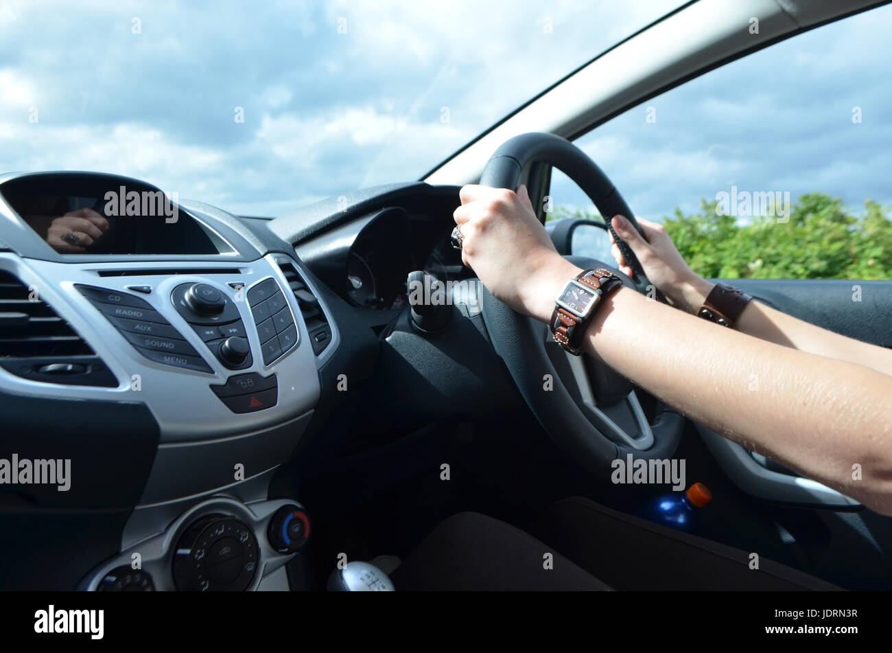 woman 39 s hands on a steering wheel driving a car on the right side stock photo royalty free. Black Bedroom Furniture Sets. Home Design Ideas
