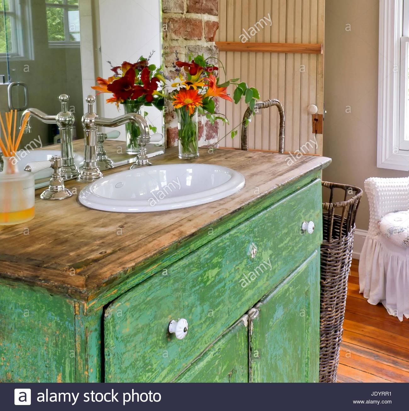 Stock Photo - Vintage Style Bathroom, Rustic Green Dresser Turned Vanity