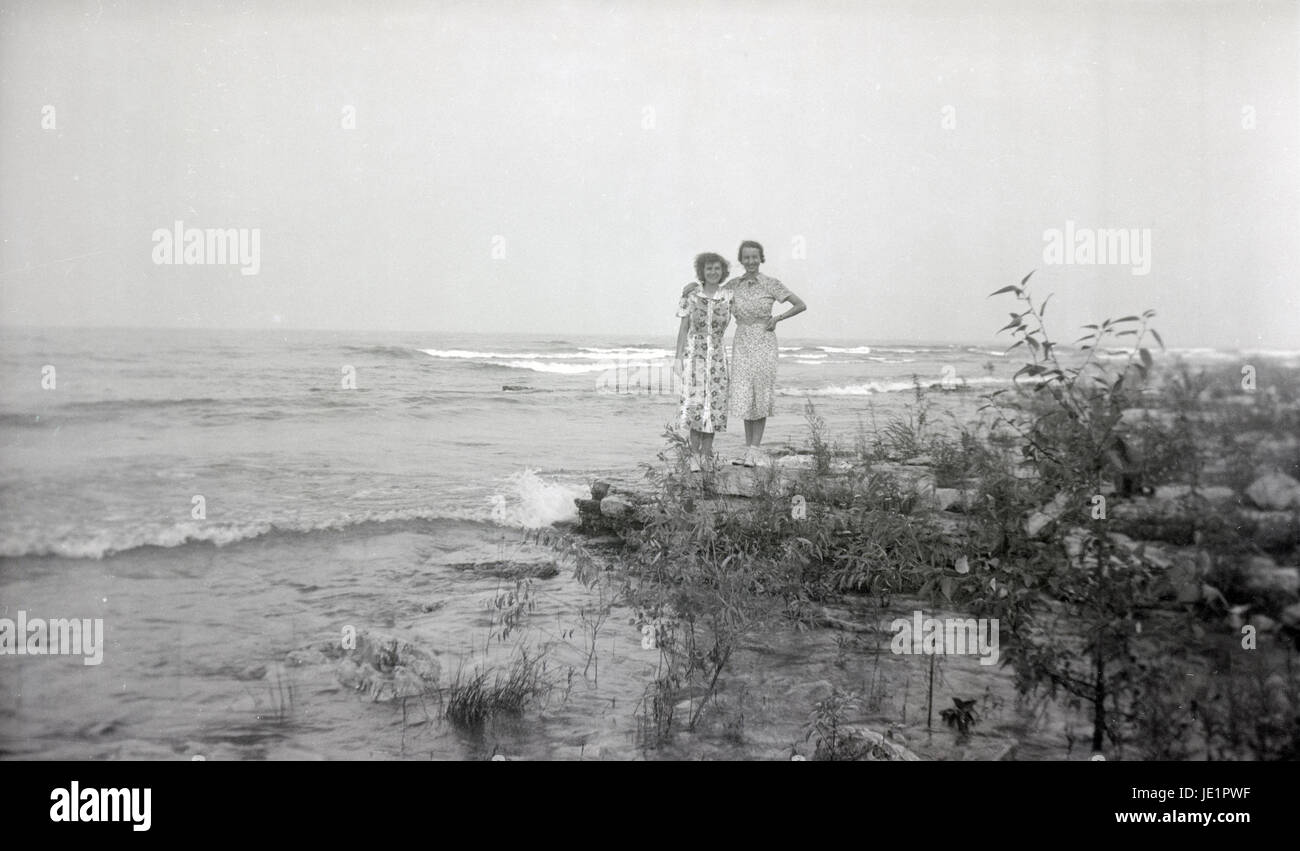 Antique c1930 photograph, two women on the rocky coast. Specific location  unknown, but possibly Door County, Wisconsin on Lake Michigan. - Antique C1930 Photograph, Two Women On The Rocky Coast. Specific