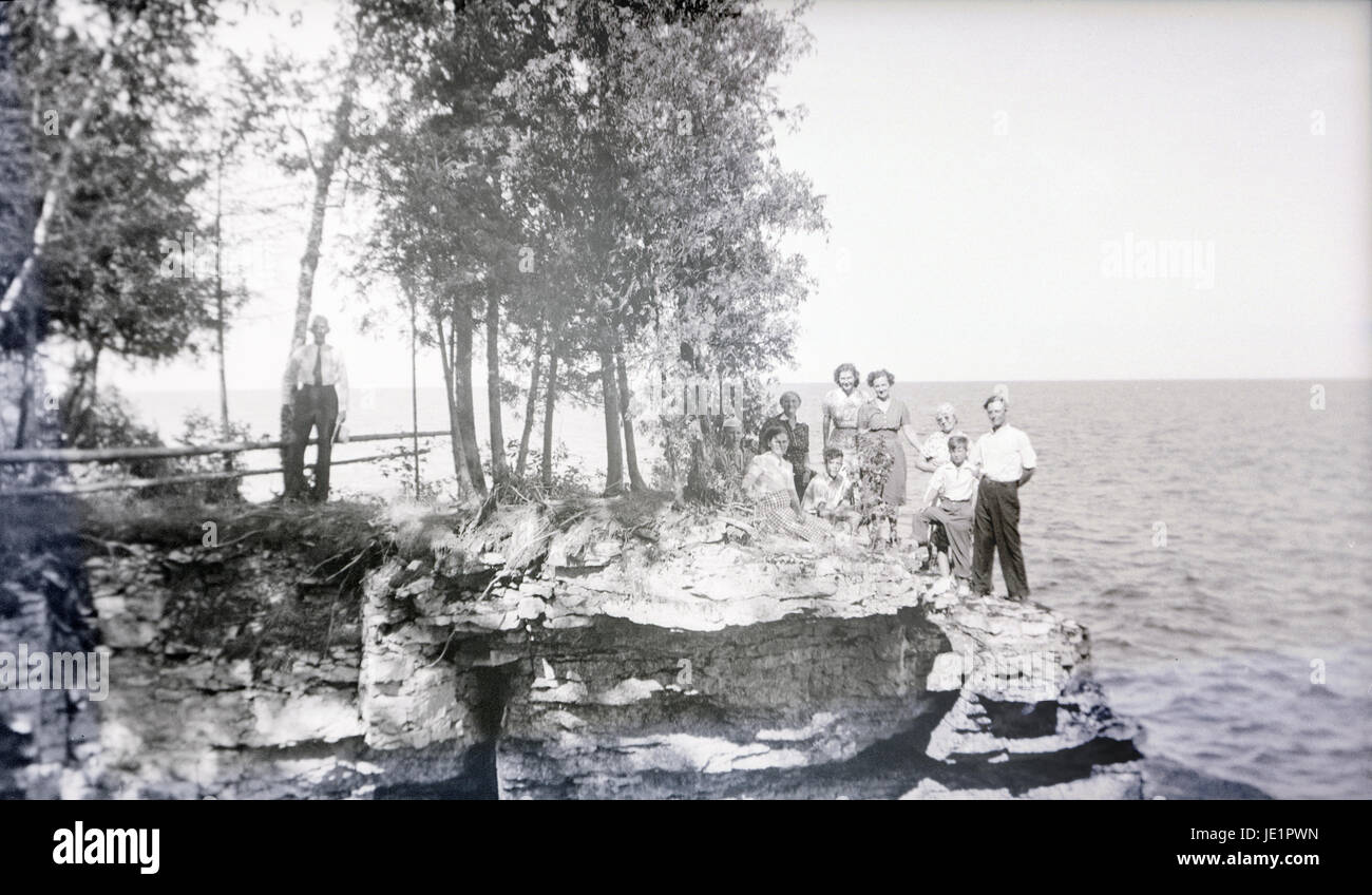 Antique c1930 photograph, family on the rocky coast. Specific location  unknown, but possibly Door County, Wisconsin on Lake Michigan. - Antique C1930 Photograph, Family On The Rocky Coast. Specific