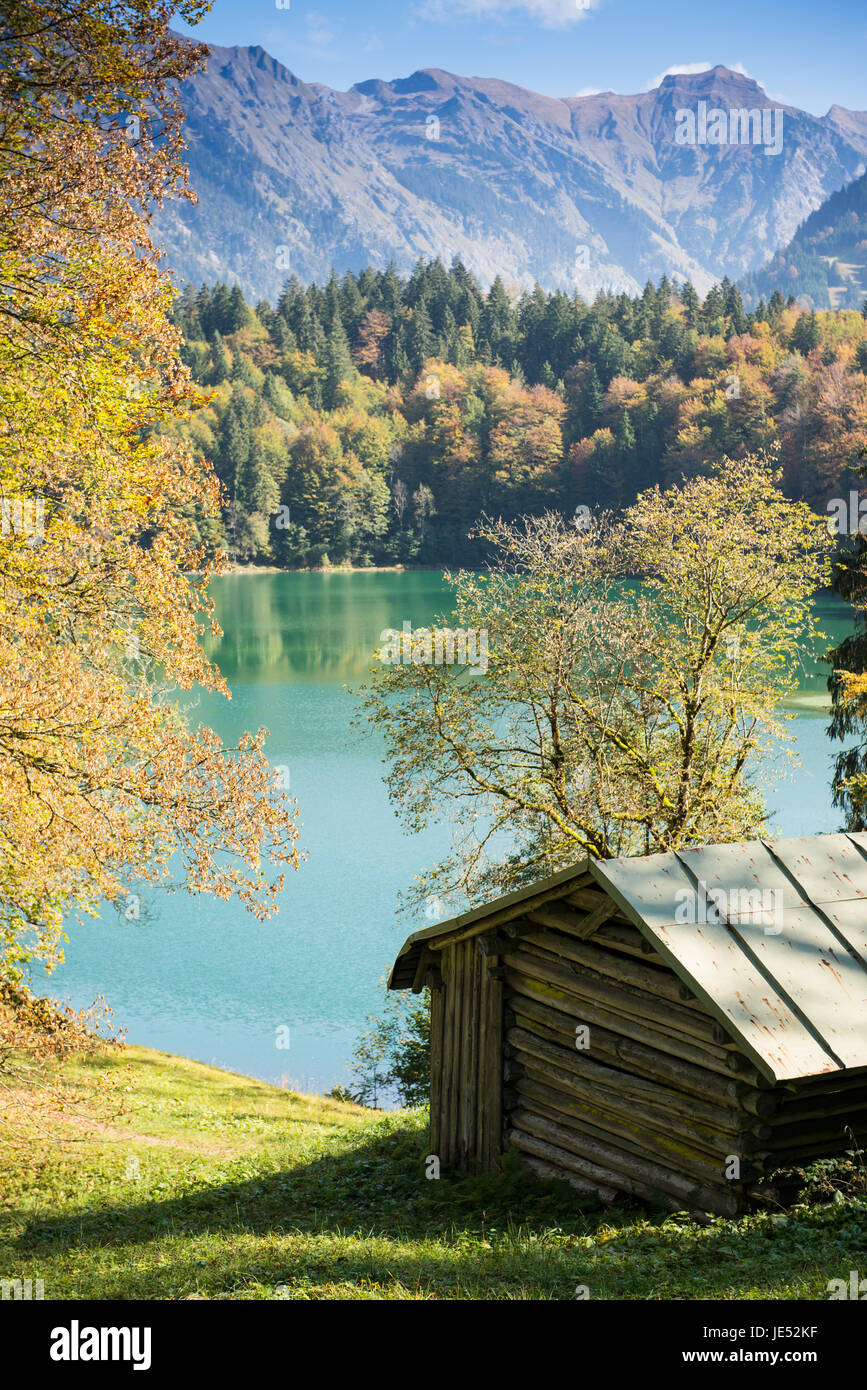h tte am see im herbst in den bergen in hochformat stock photo royalty free image 146400003. Black Bedroom Furniture Sets. Home Design Ideas