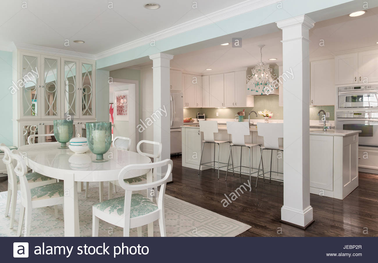 Kitchen And Oval Breakfast Table And Mirrored Cabinet, Aqua Walls