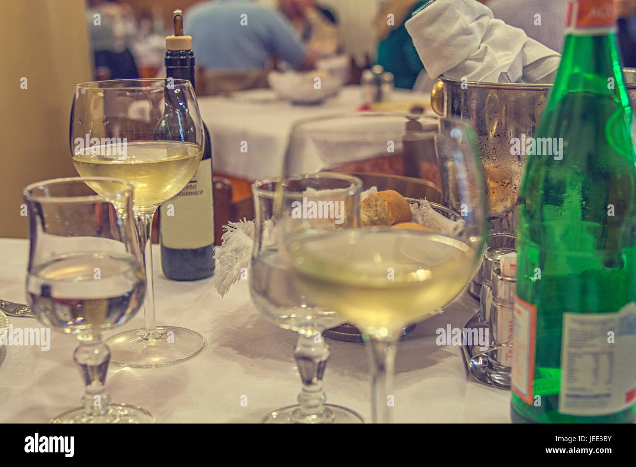 Stock Photo   Table Setting After A Dinner In An Italian Restaurant With  Wine, Bottle, Water, And Bread