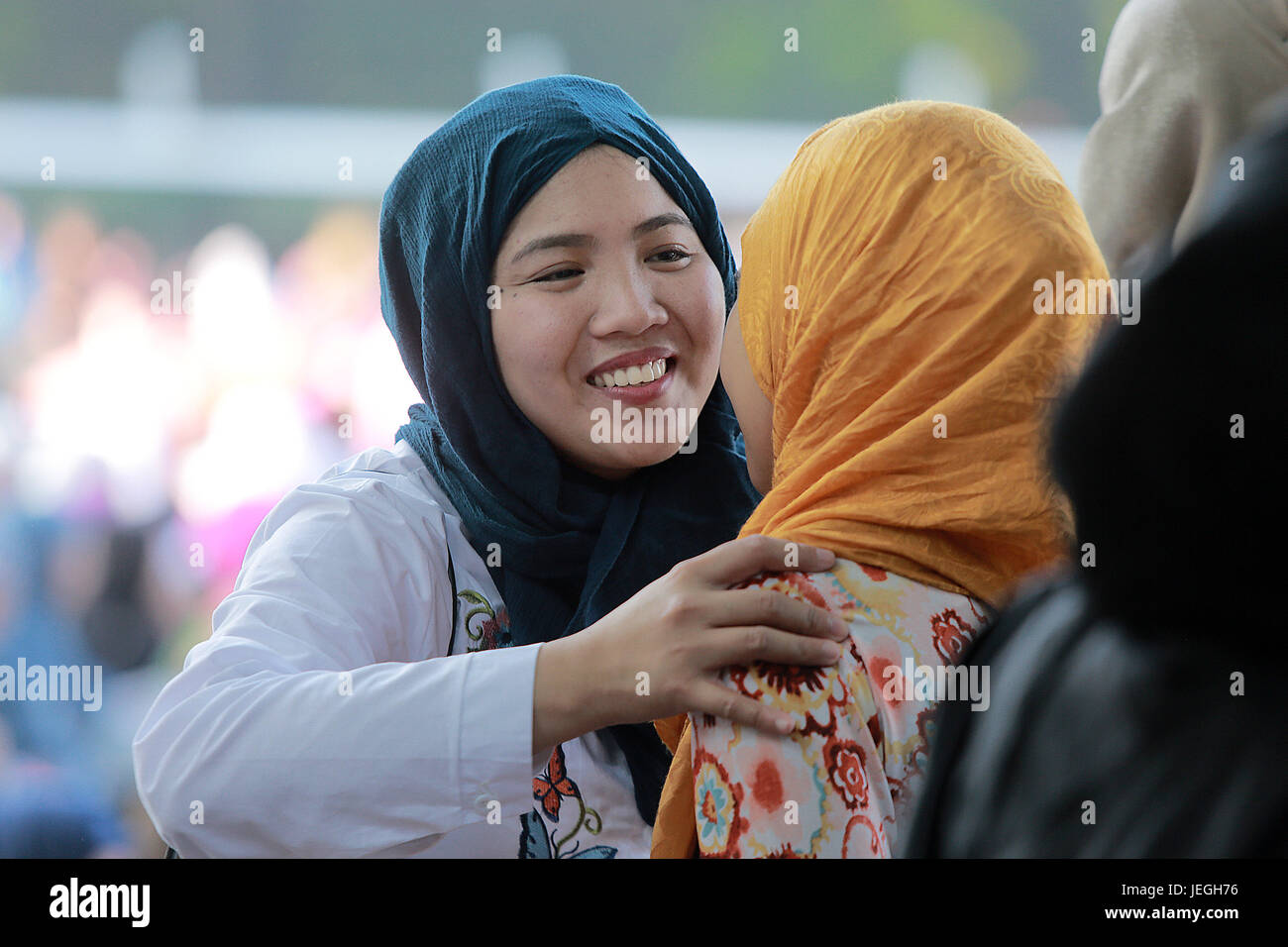 Quezon city philippines 25th june 2017 muslim women greet each muslim women greet each other after a prayer in celebration of the eid al fitr in quezon city the philippines june 25 2017 kristyandbryce Images