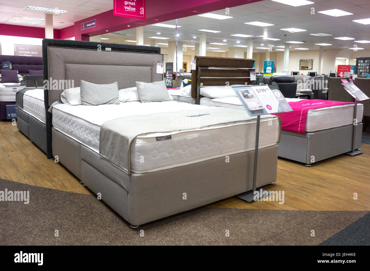 Interior inside bensons beds bed store shop bedroom for Bedroom furniture warehouse