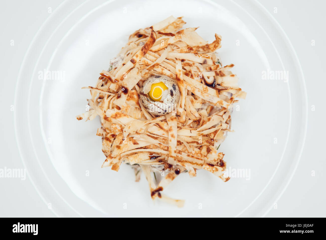 Salad in the form of a nest and decorated with quail eggs Stock ...