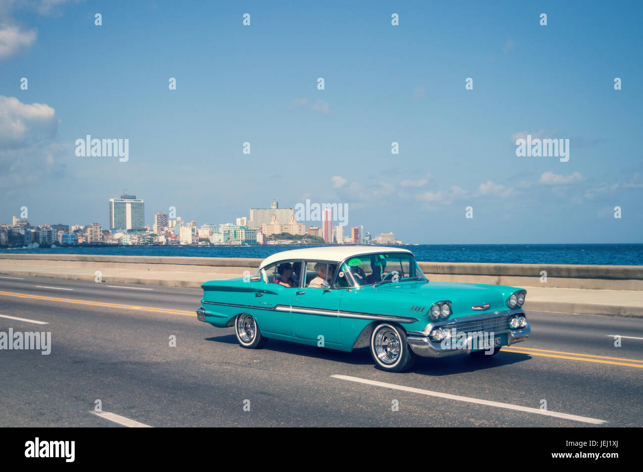 HAVANA, CUBA - April 18: Blue old classic cars on the Malecon, the ...