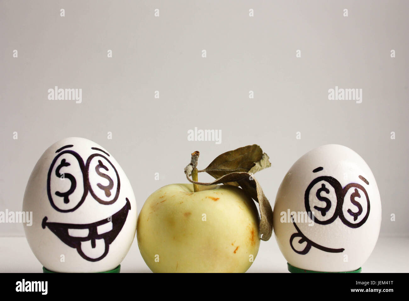 Business Idea Eggs With Face And Eyes With Dollars And An Apple Photo For Your Design