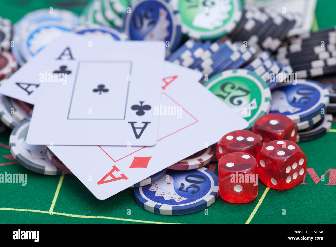 Casino Chips, Cards And Dices On Green Felt Game Table