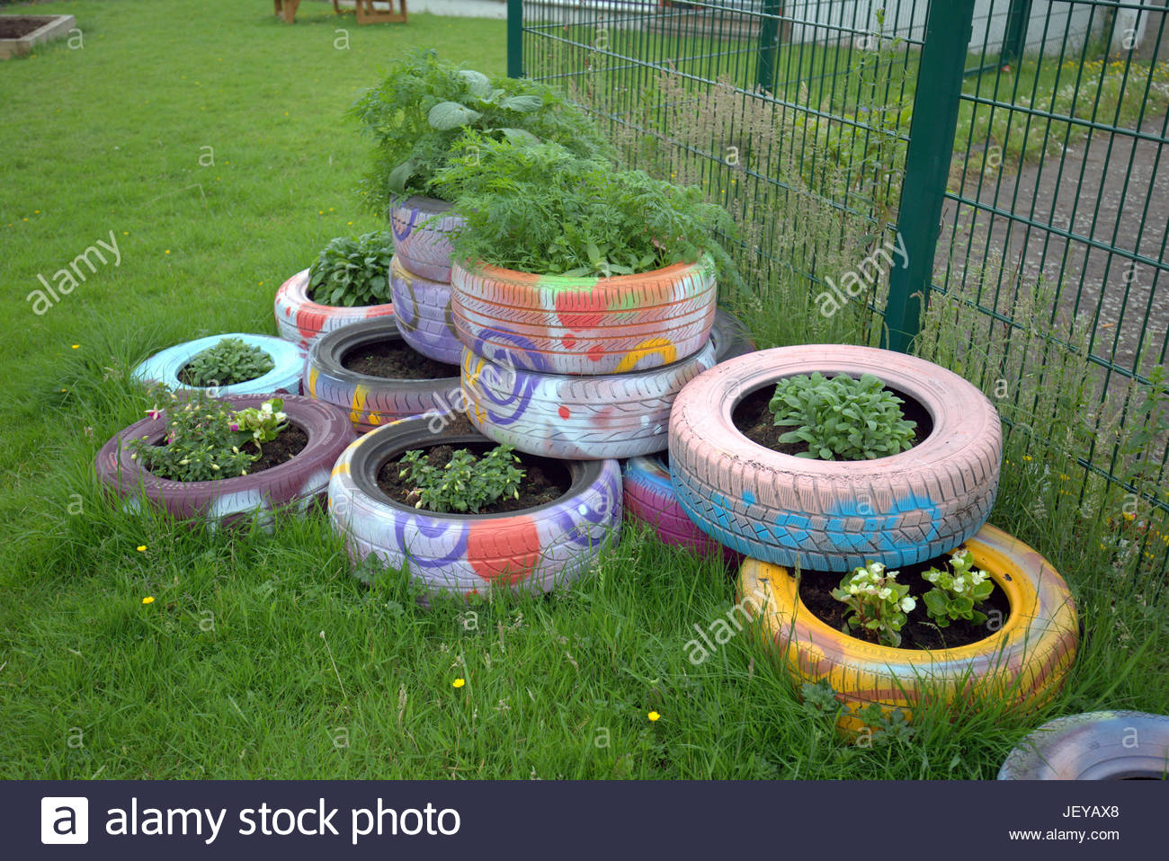recycled tires tyres used as plant pots upcycling ideas how to use everyday objects as design features in a garden - Garden Ideas Using Tyres