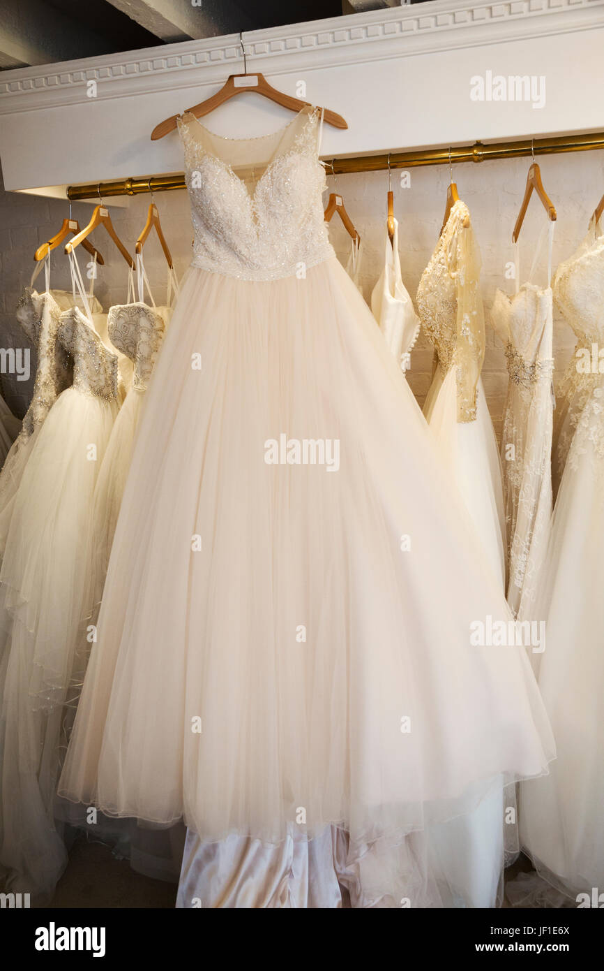 Rows of wedding dresses on display in a specialist wedding dress rows of wedding dresses on display in a specialist wedding dress shop a white dress ombrellifo Gallery