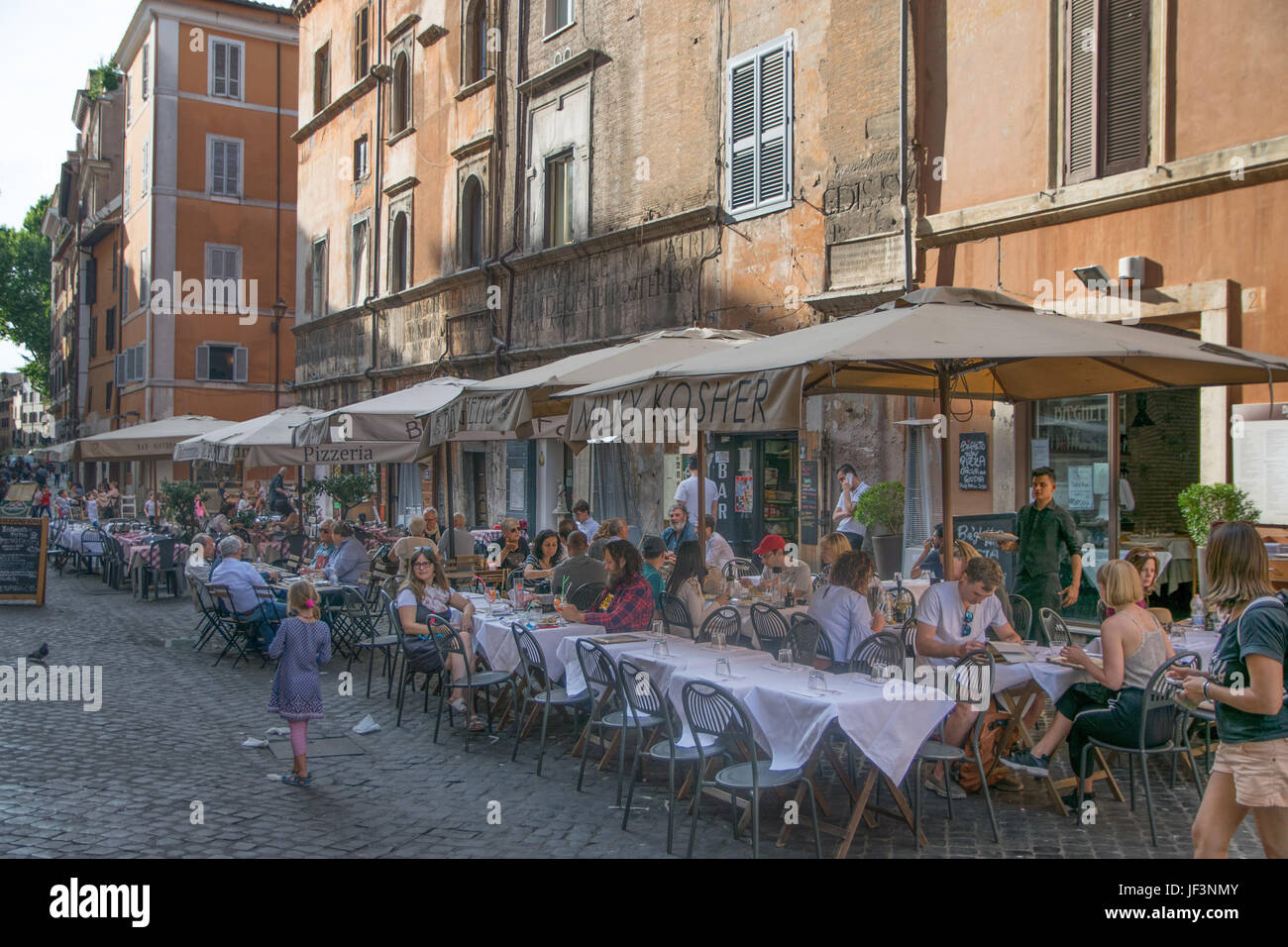 rome, italy - june 11, 2017: unidentified people eating
