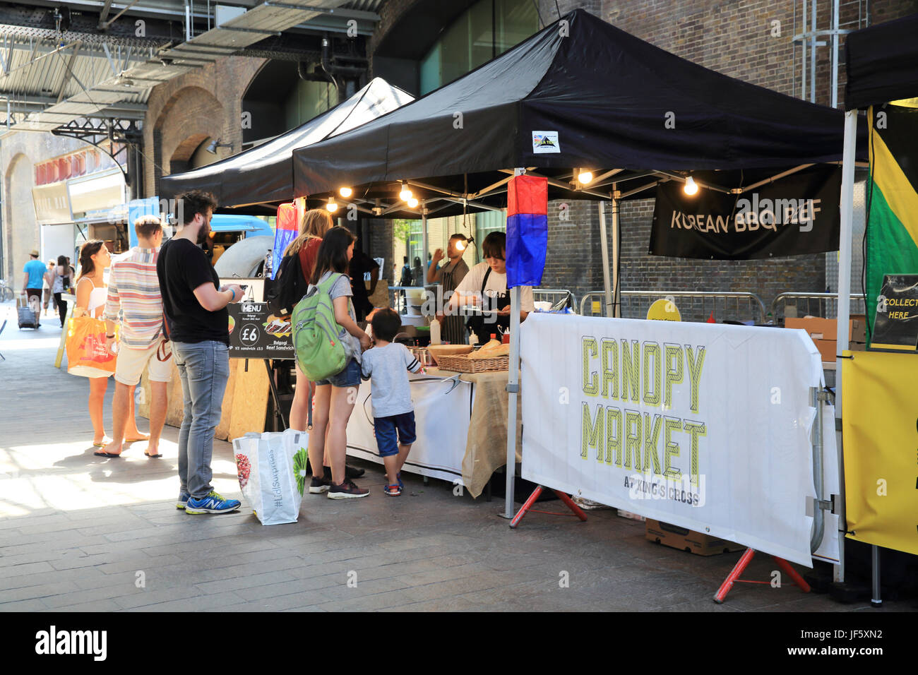 Artisan street food on sale at the Kings Cross Canopy Market in the historic West Handyside Canopy in north London UK & Artisan street food on sale at the Kings Cross Canopy Market in ...