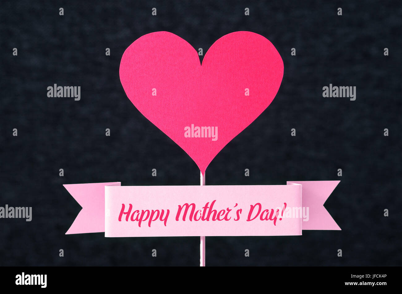 Happy mothers day text on a ribbon and red heart shape cut from happy mothers day text on a ribbon and red heart shape cut from cardboard on wooden stick nice simple greeting design for mothers day card kristyandbryce Choice Image