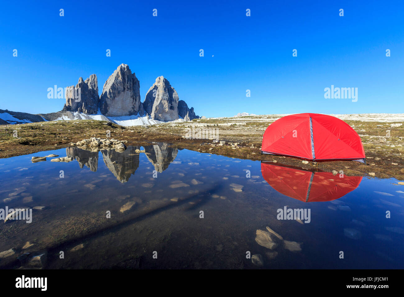 Hikers tent in front of the Three Peaks of Lavaredo at sunrise Sesto Dolomites Trentino Alto Adige Italy Europe & Hikers tent in front of the Three Peaks of Lavaredo at sunrise ...
