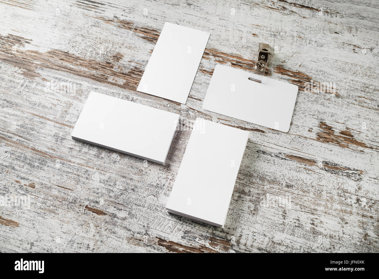 Bank business cards and badge on vintage wood table background ...