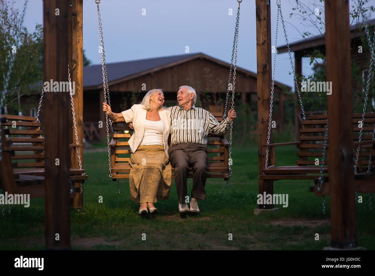 old couple on porch swing stock photo royalty free image