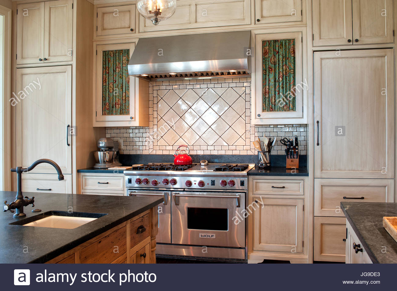 Country kitchen tile back splash wolf double oven range red stock country kitchen tile back splash wolf double oven range red kettle custom cabinetry soap stone counter dailygadgetfo Gallery