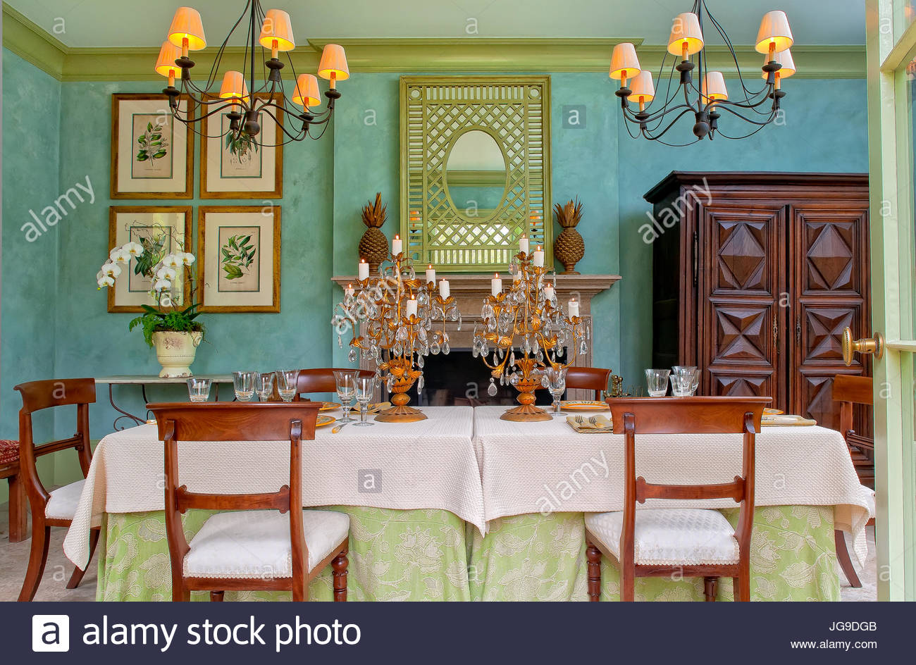 Dining Area, Aqua Walls, Chandeliers, Antique Chairs, Armoire, Fireplace,  Moss Green Crown Molding, Pineapple Decor, Table Set